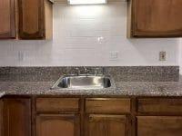 Studio apartment kitchen sink and backsplash