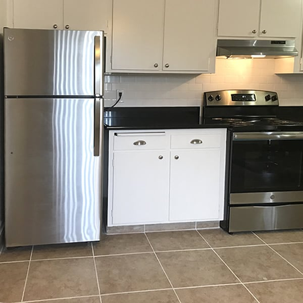Kitchen with stainless refrigerator