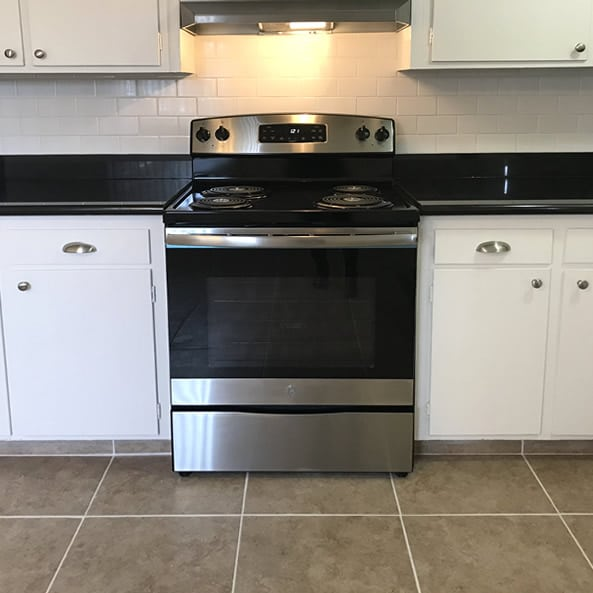 Kitchen with upgraded stainless range and hood